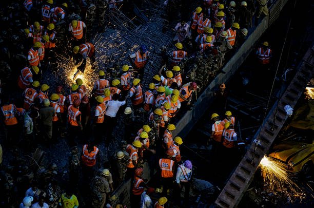 flyover collapse-kolkata - debiprasad mukherjee stock photos and pictures