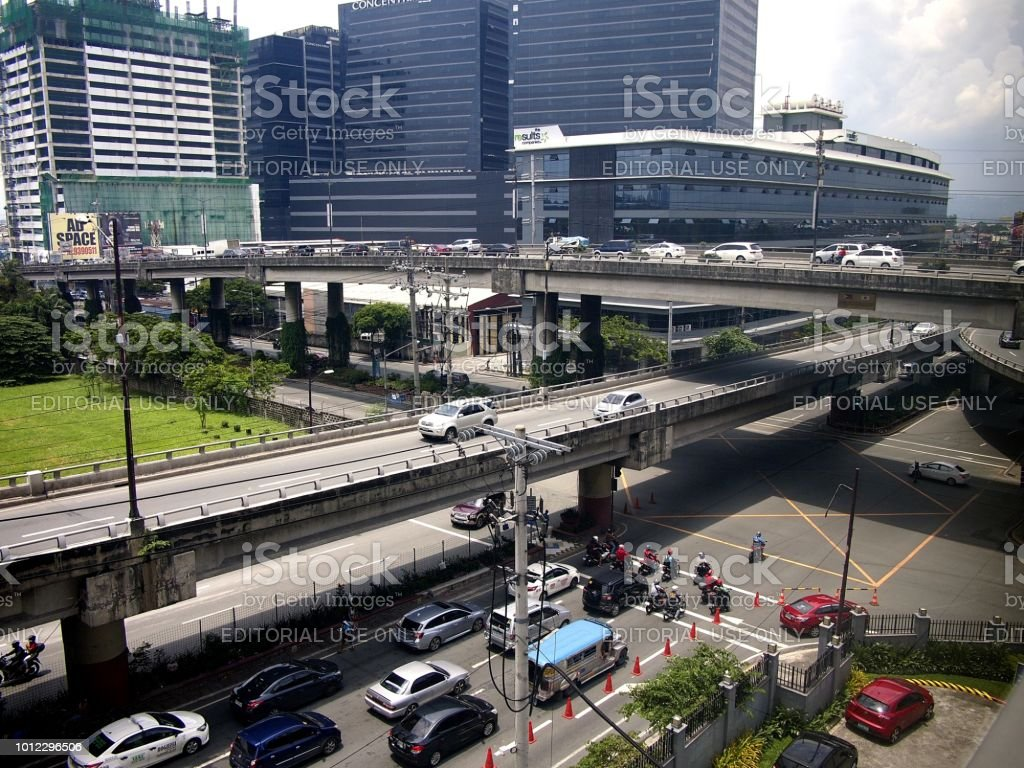 Flyovers, buildings and bridges at a busy intersection in Pasig City, Philippines. stock photo