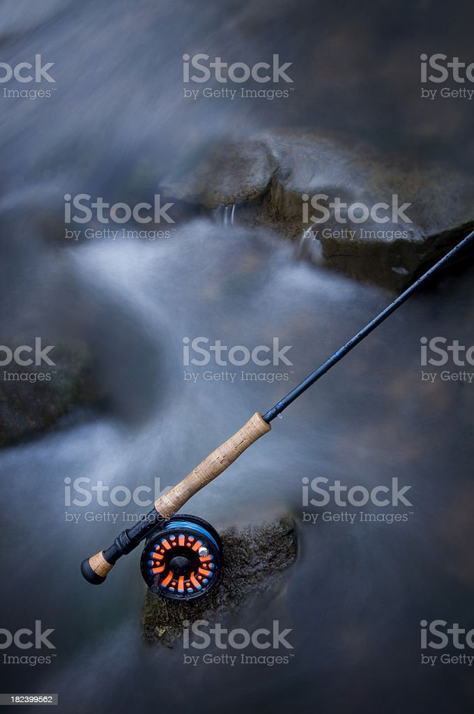 Flyrod in icy creek stock photo