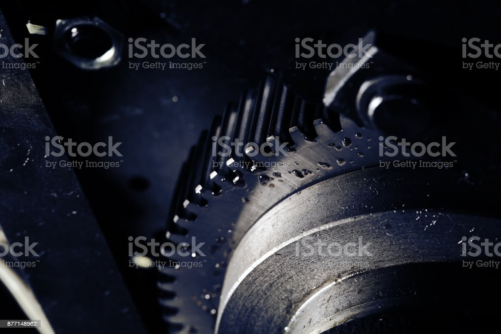 Flywheel with oil drops close-up stock photo