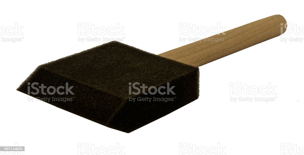 Foam brush with wooden handle on side stock photo