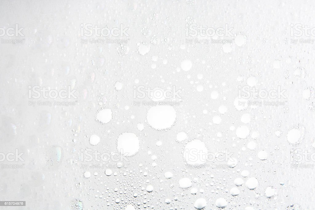 Foam bubble from soap or shampoo washing on top view stock photo