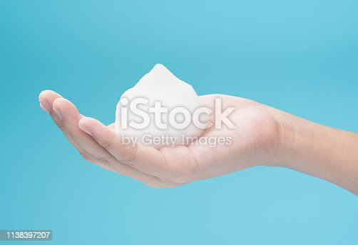 istock Foam bubble on hand female isolated on blue background beauty health care object concept design 1138397207