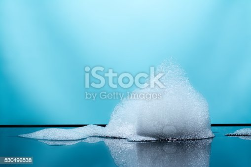 istock foam, bubbles with reflection, blue background 530496538