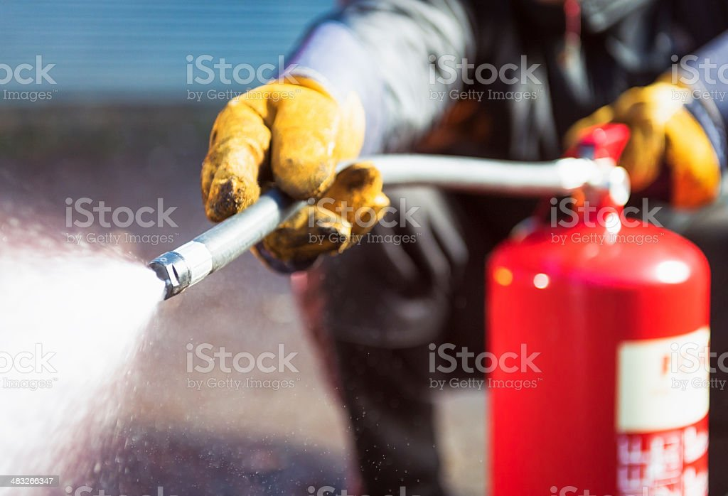 Foam fire extinguisher in action stock photo