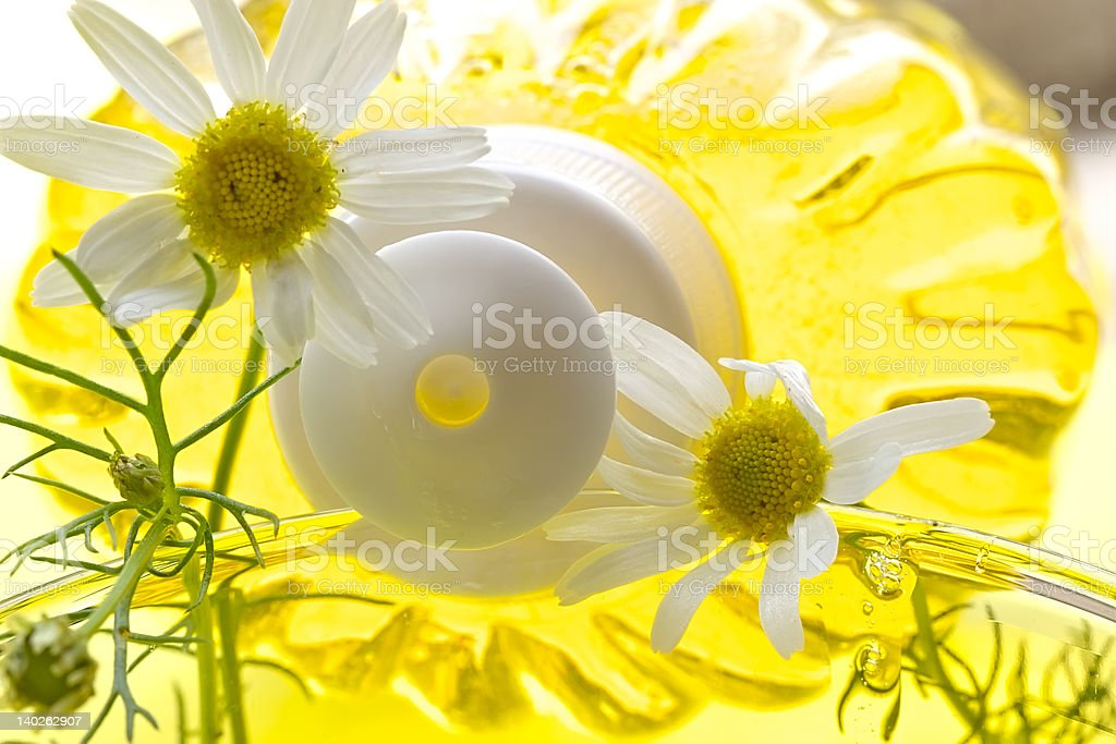 Foam for a bath with camomile royalty-free stock photo