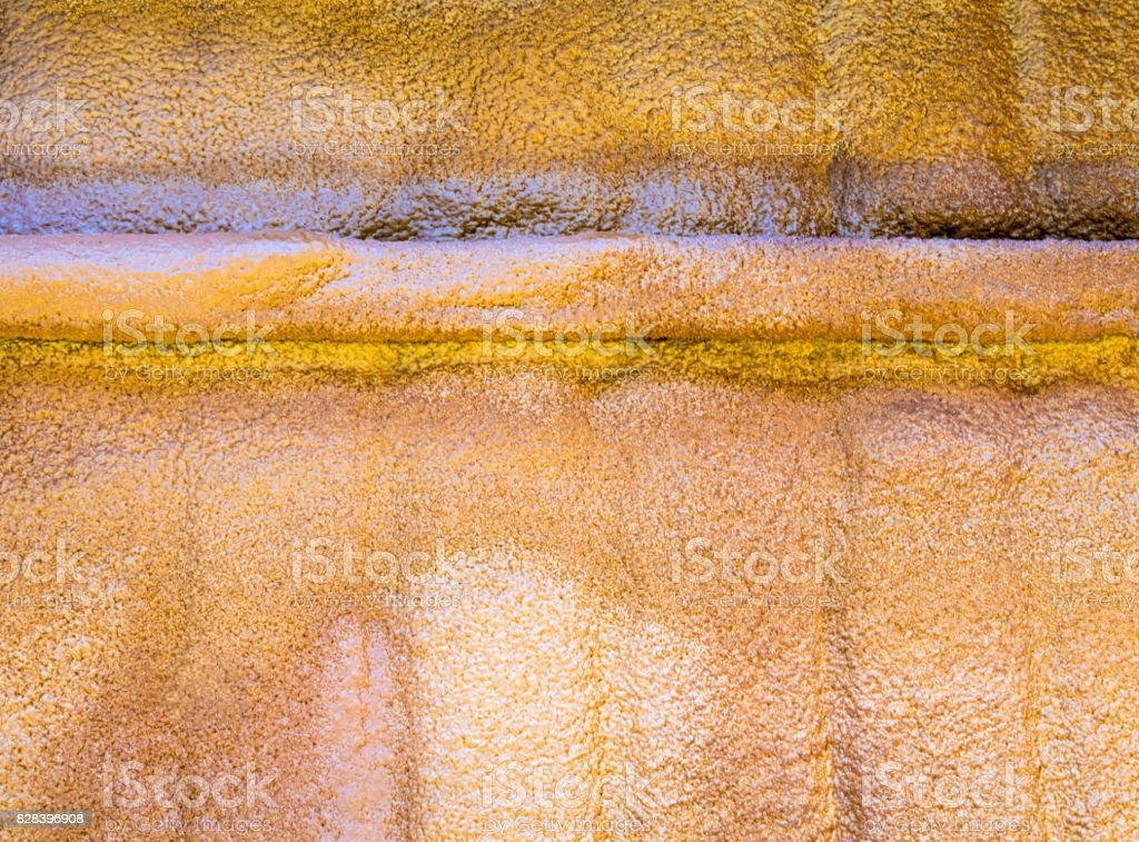 Foam injected under the roof sheet as insulation stock photo