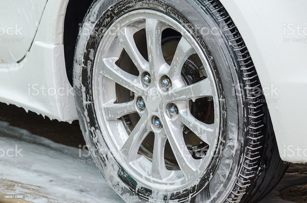 Foam on the wheels during car wash. stock photo