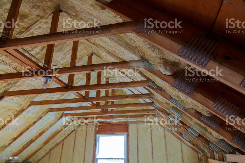 Foam plastic Insulation on a new roof stock photo