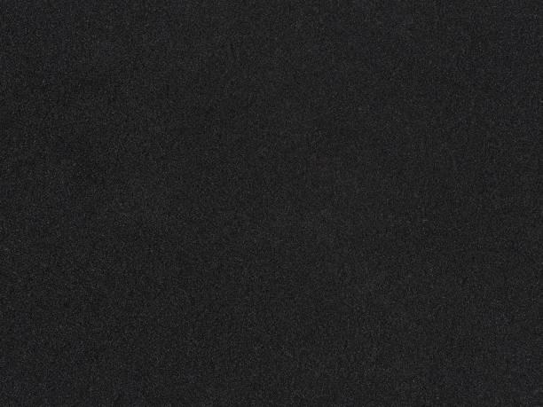 foam rubber texture. black sponge background. dark polystyrene - materiale gommoso foto e immagini stock