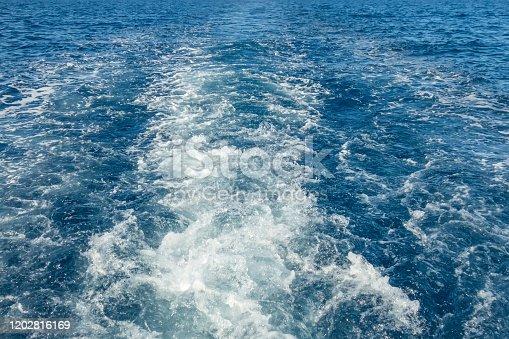 Foam trace waves blue sea water texture splashing motion yacht cruise