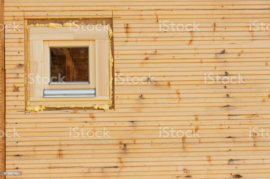 Foam window insulation on wooden construction. stock photo