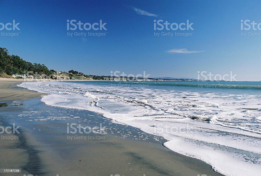 Foamy Hawaii beach stock photo