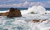 sea foam smothering the black rocks