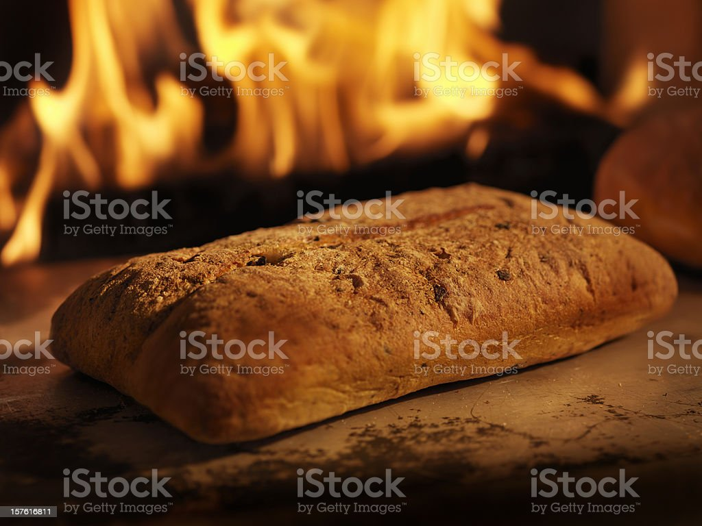 Focaccia Bread in a Wood Burning oven royalty-free stock photo