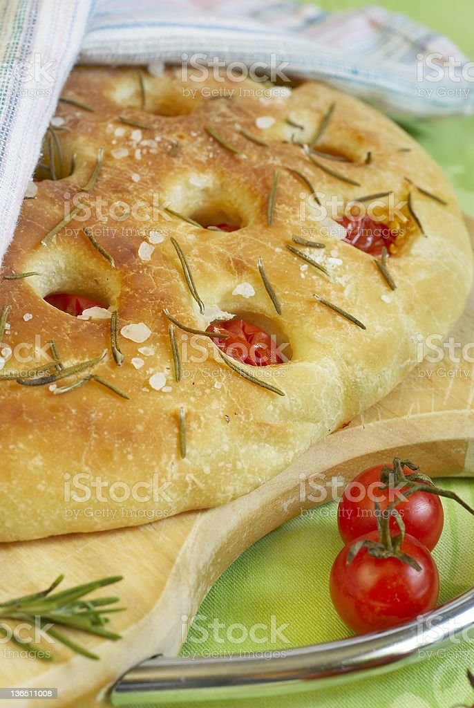Focaccia bread with cherry tomatoes, rosemary and salt royalty-free stock photo