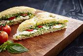 Focaccia Sandwich with mozzarella, tomato and pesto