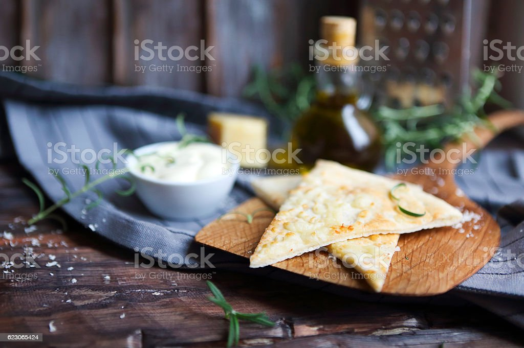 Focaccia with olive oil, parmesan cheese, white sause and rosema stock photo