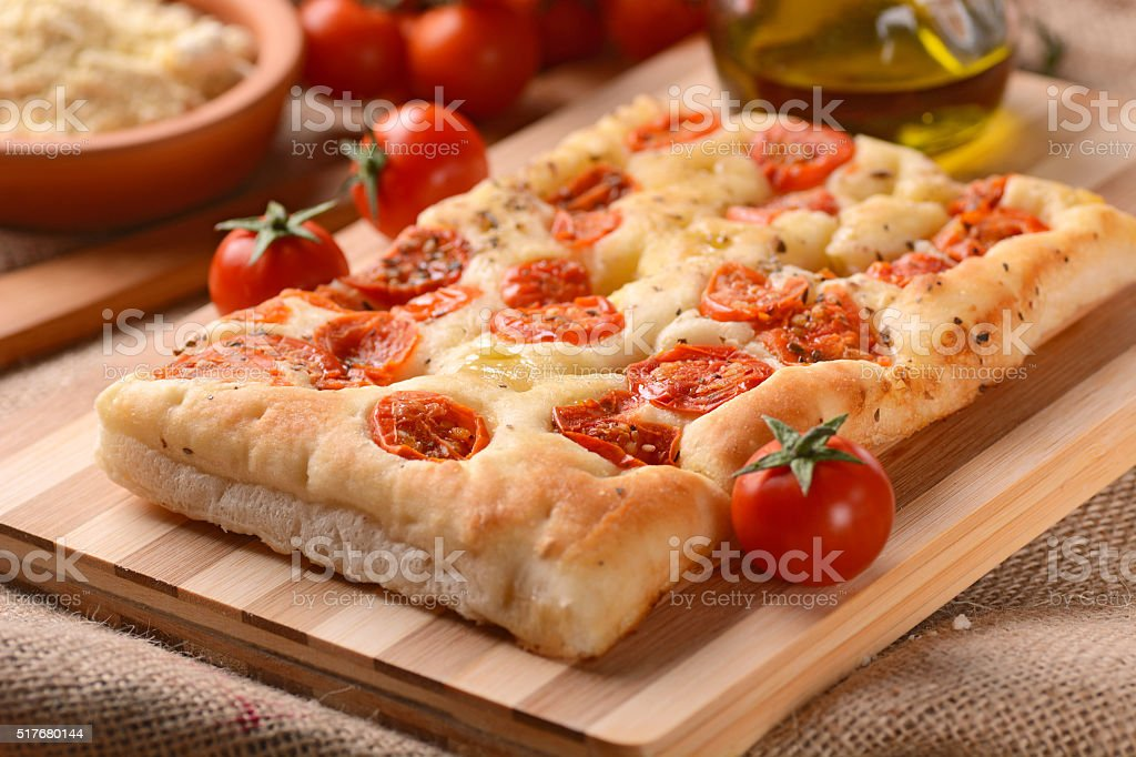 focaccia with tomatoes stock photo