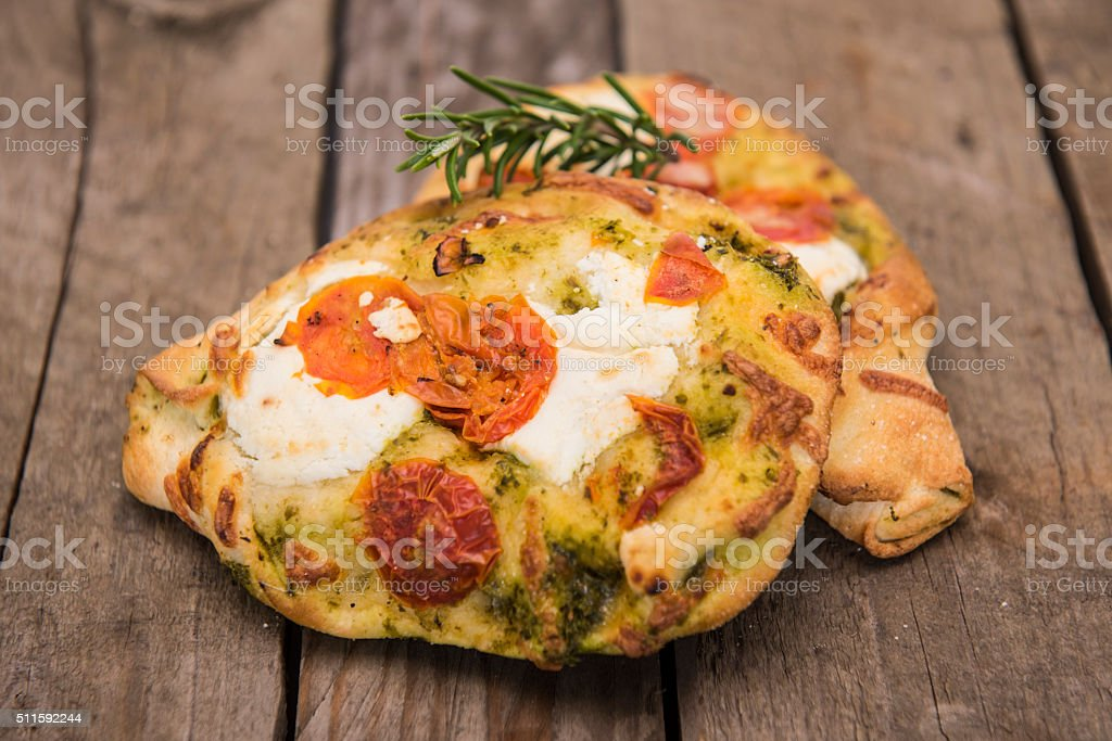 Foccacia with tomato and goats cheese and Pesto stock photo
