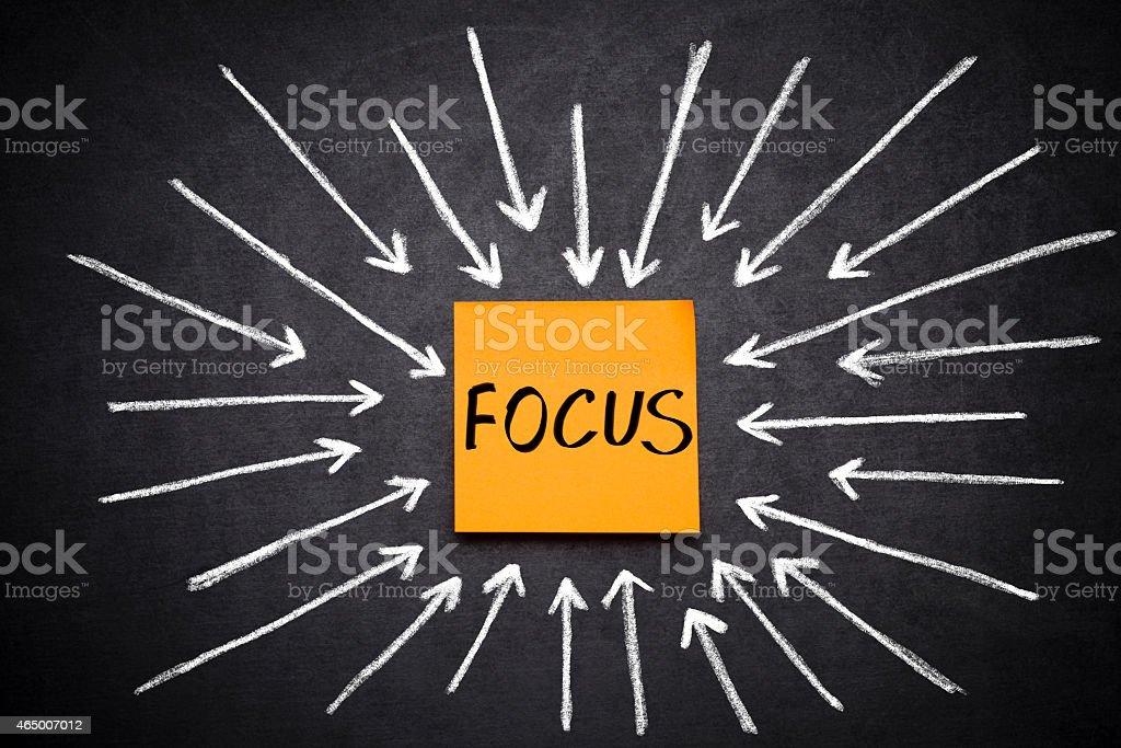 Focus and arrows on blackboard stock photo