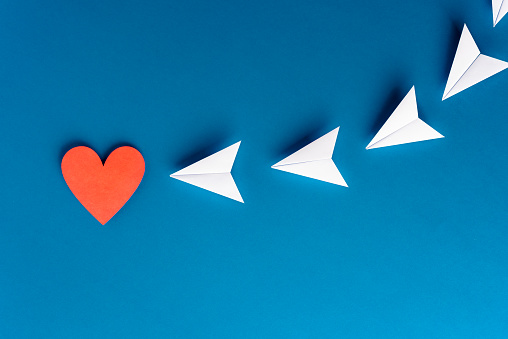 istock Focus, assertiveness, work yourself concept. Flying paper planes origami with heart shape on blue background. Business and solution concept. 1172256269