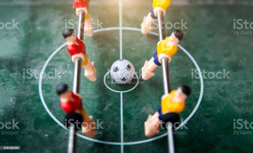 focus ball in start soccer table game. Boy toy sport game concept....