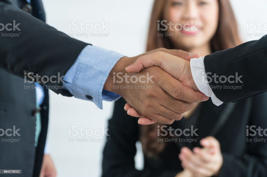 Focus hand handshake of two businessmen. royalty-free stock photo