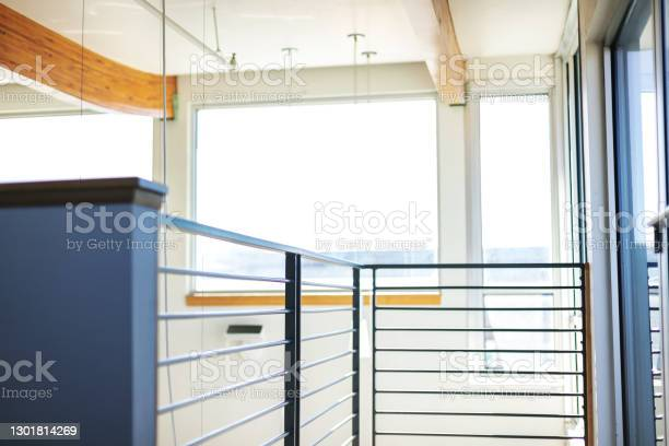 Focus In Distance Horizontal Pattern Modern Stair Rail Landing In Corporate Business Office Stock Photo - Download Image Now
