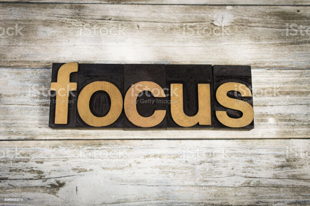 Focus Letterpress Word on Wooden Background stock photo
