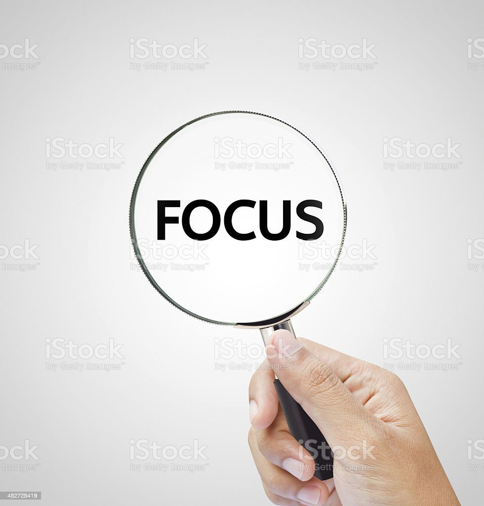 focus letters under the magnifier stock photo