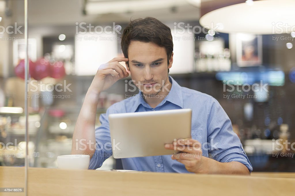 Focus man in cafe with digital tablet royalty-free stock photo