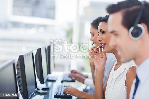istock Focus of smiling call centre agent 849525964