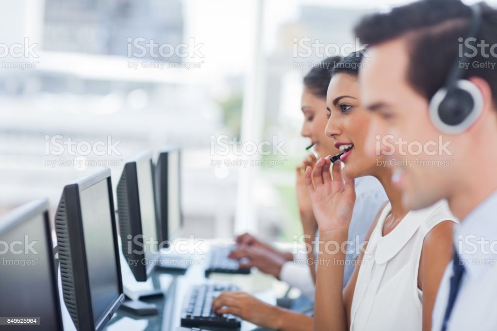 Focus of smiling call centre agent stock photo