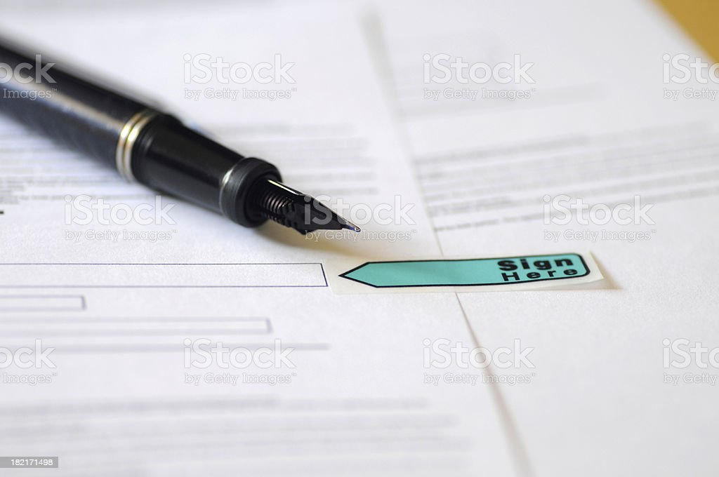 Focus of tip of fountain pen resting on a contract royalty-free stock photo