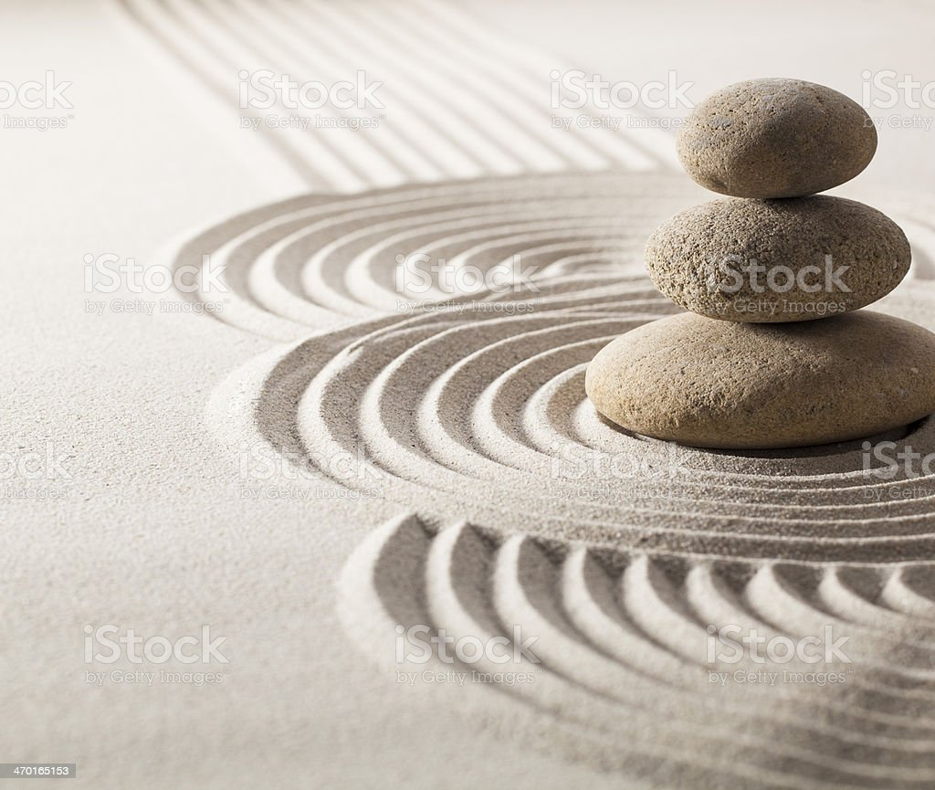 focus on balancing stones in sand for progression in life royalty-free stock photo