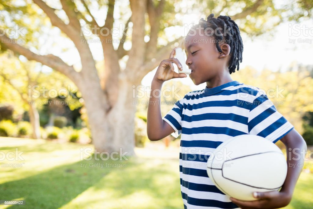 Focus on child holding an object stock photo