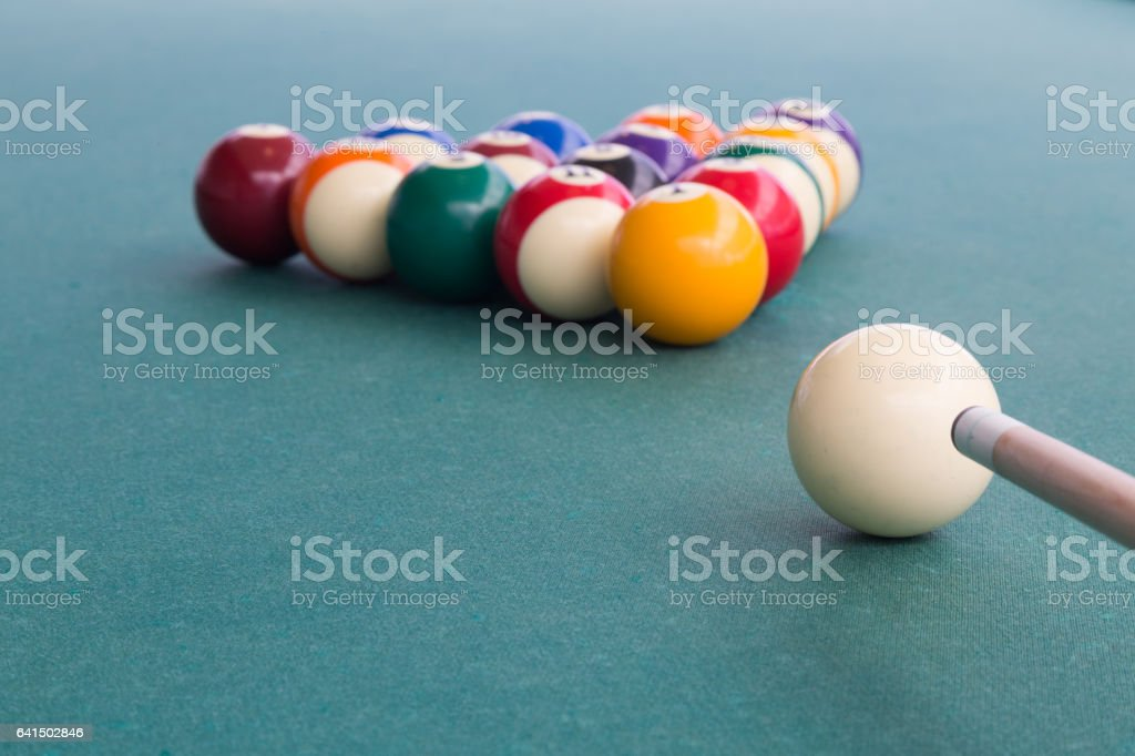 Focus on cue aiming white ball to break snooker billards stock photo