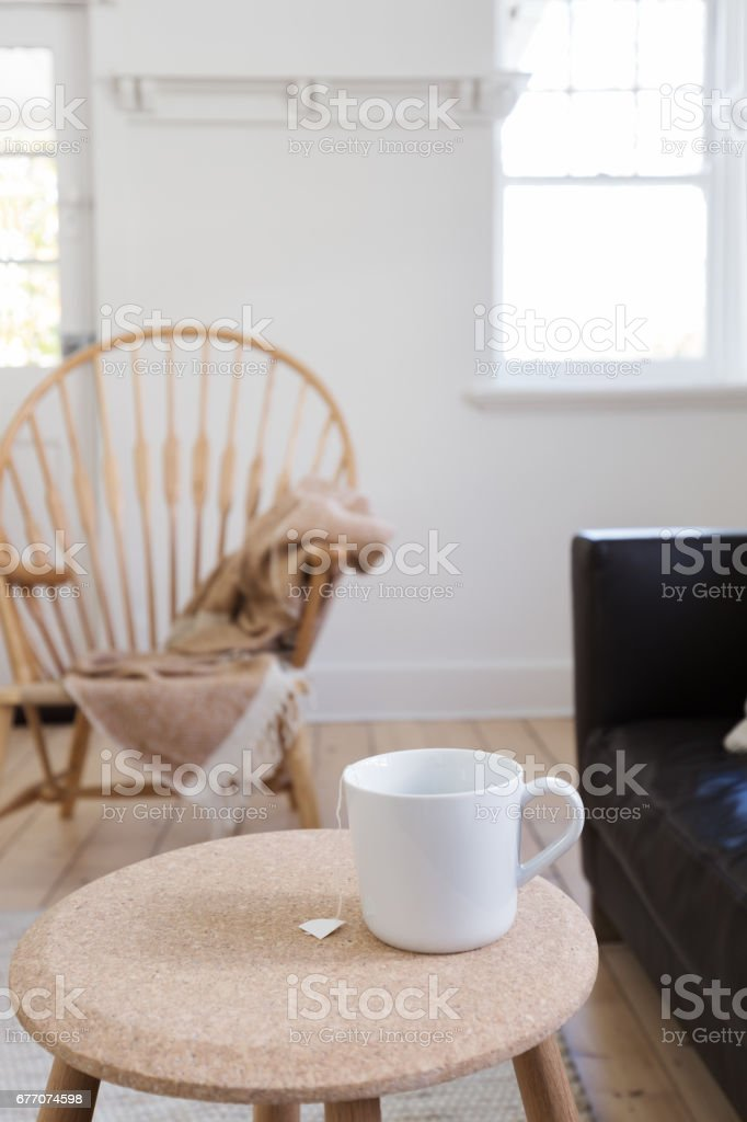 Focus on cup of tea in contemporary styled living room stock photo