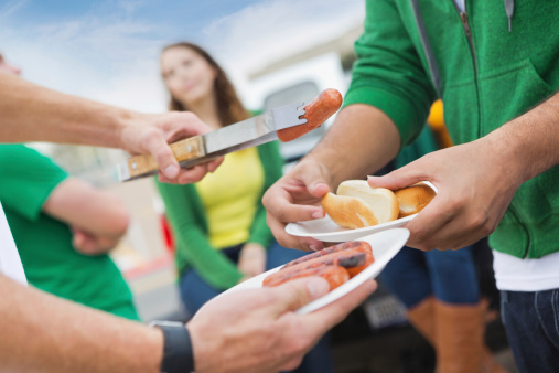 Focus on food at college football stadium tailgate party