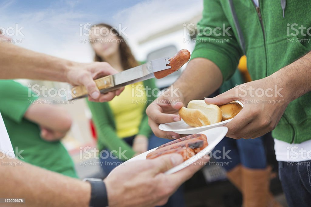 Focus on food at college football stadium tailgate party stock photo