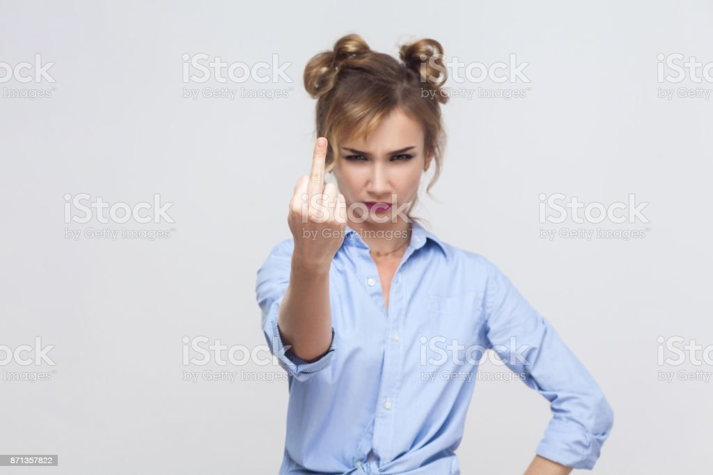 Focus on hand. Fuck sign, pointing at camera stock photo