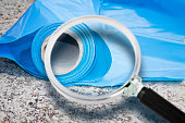 istock Focus on polyethylene protection vapour barrier to restrict the passage of vapour from the hot part of the structure to the cold part of roof and wall and protect it from problems caused by the formation of condensation - Concept image seen through a magn 1287806562