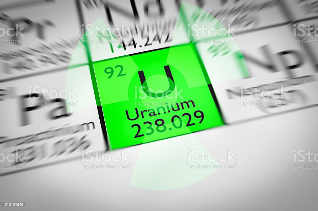 Focus on radioactive green Uranium Chemical Element stock photo