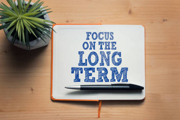 Focus on the long term Focus on the long term motivational quote long stock pictures, royalty-free photos & images