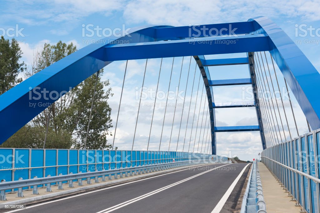 Focus on the railing on the bridge, which is visible in background stock photo