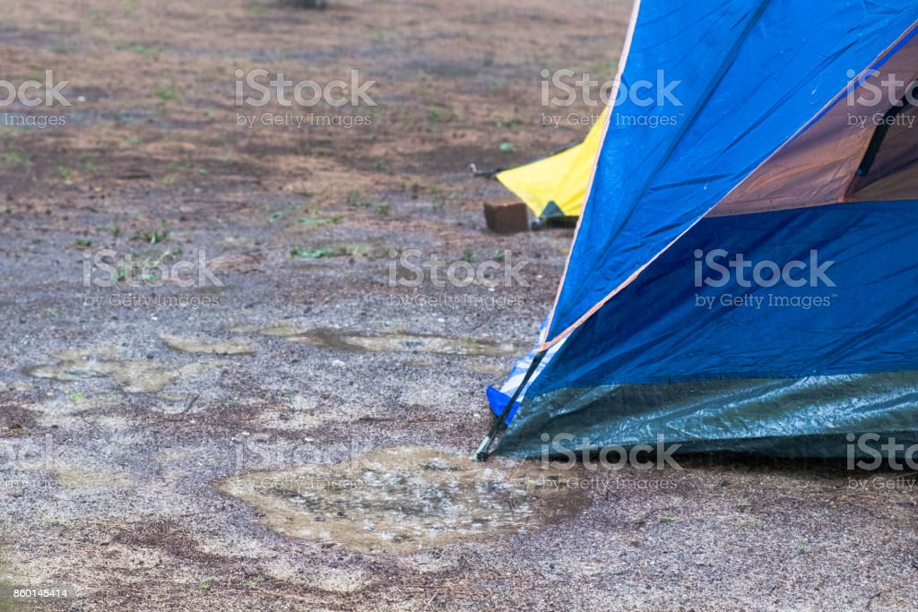 Focus On The Tent Among Raining Field Stock Photo - Download
