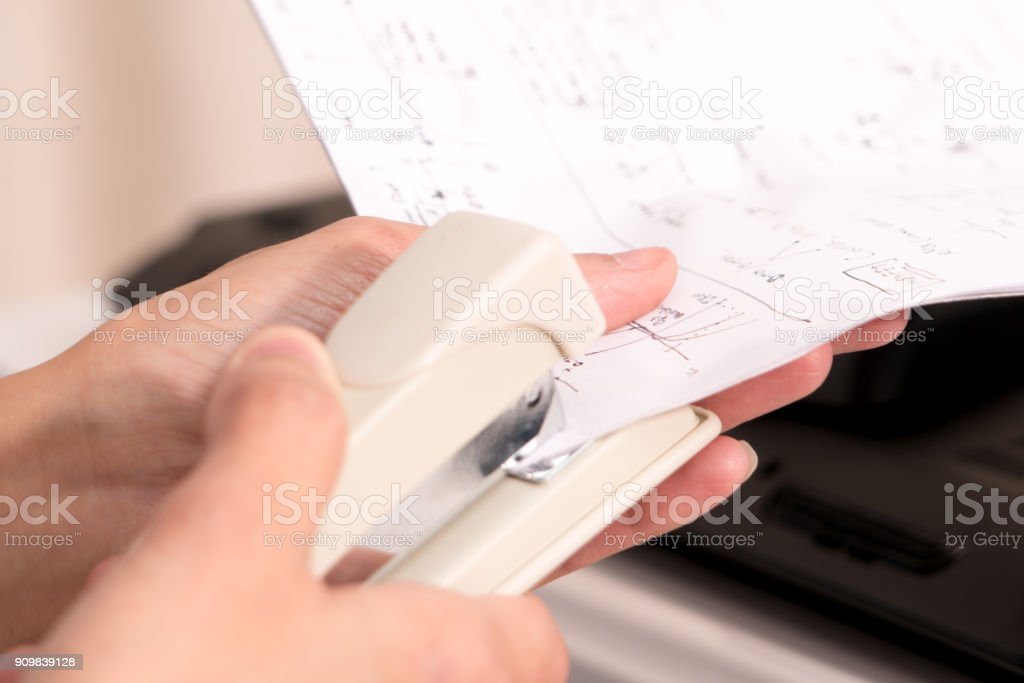 focus on the women hand stapling the hand writing paper, working and office concept - fotografia de stock