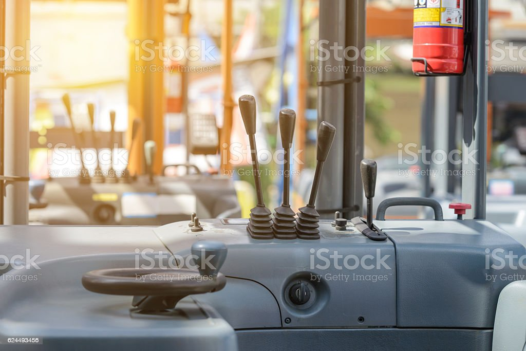 Focus to levers wheel control in cabin forklift truck – Foto