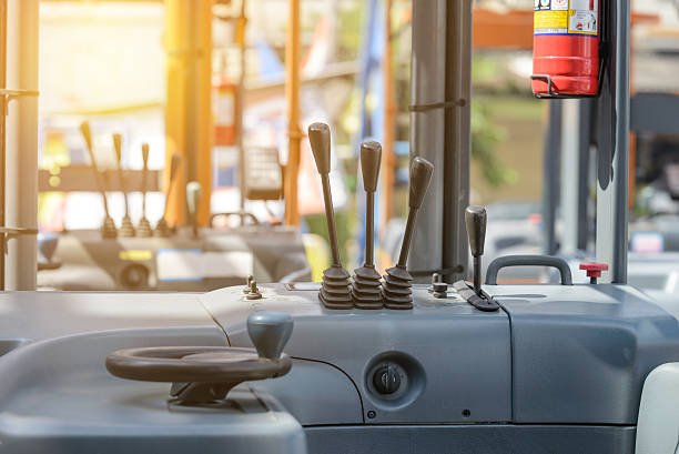 focus to levers wheel control in cabin forklift truck - dashboard vehicle part stock photos and pictures